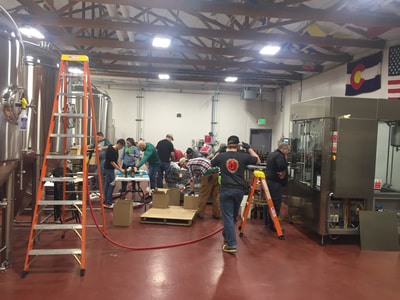 Full team working on bottling line.