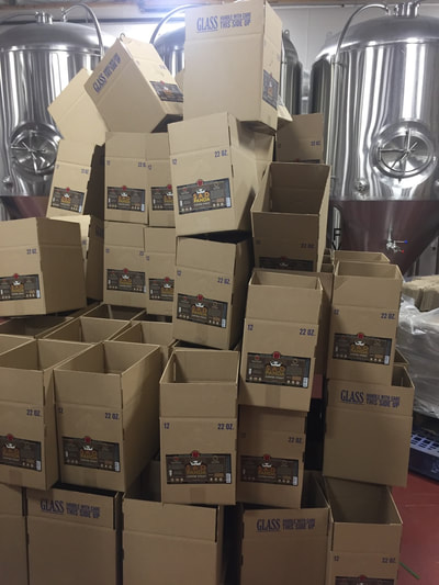 Pile of empty boxes awaiting bottles.